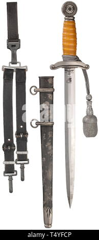 A dagger M 38 for leaders, complete with service hanger and sword knot. The blade (minimally stained) with reverse Eickhorn logo and TeNo acceptance, obverse arms number '2879'. Silvered quillons and pommel with areas of patina, orange-coloured plastic grip. The scabbard (small dent) with mostly intact black toning, the locket with matching number '2879'. Length 41 cm. Complete with service hanger and belt loop of dark blue leather. historic, historical, technical, technic, emergency aid, object, objects, stills, clipping, clippings, cut out, cut-out, cut-outs, utensil, pie, Editorial-Use-Only - Stock Photo