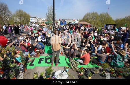 Extinction Rebellion demonstrators hold a community meeting on Waterloo Bridge in London. - Stock Photo