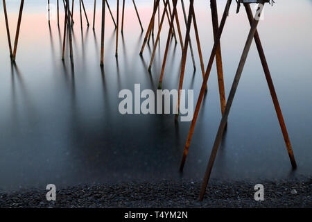 Abstract Look Of The Rusty Metal Pipes Are On The Sea Surface - Stock Photo