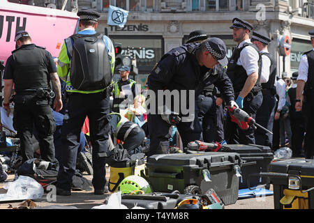 Police prepare to remove Extinction Rebellion demonstrators from the boat at Oxford Circus in London. - Stock Photo