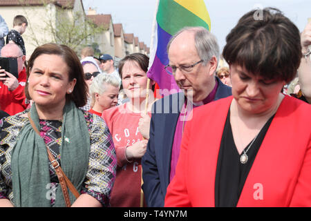 Sinn Fein Leader Mary Lou McDonald (left), DUP leader Arlene Foster (right) with Sara Canning (centre), the partner of 29-year-old journalist Lyra McKee, at a vigil in Londonderry, Northern Ireland, following her death last night after guns were fired and petrol bombs were thrown in what police are treating as a 'terrorist incident'. - Stock Photo