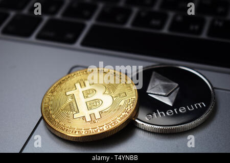 Bitcoin and ethereum on a laptop - Stock Photo
