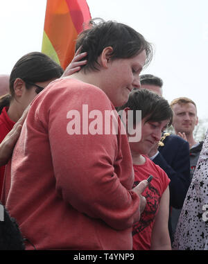 Sara Canning (left), the partner of 29-year-old journalist Lyra McKee at a rally in Londonderry, Northern Ireland, following her death last night after guns were fired and petrol bombs were thrown in what police are treating as a 'terrorist incident'. - Stock Photo