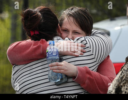 Sara Canning (right), the partner of 29-year-old journalist Lyra McKee at a rally in Londonderry, Northern Ireland, following her death last night after guns were fired and petrol bombs were thrown in what police are treating as a 'terrorist incident'. - Stock Photo
