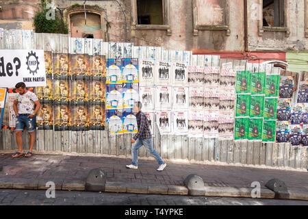 Istanbul, Turkey - June 13, 2016: Unknown man in casual wear walking in the sideways of a local street in Istanbul. - Stock Photo