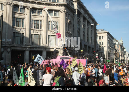 Police take control of Extinction Rebellion's 'Tell the Truth' boat, as protests continue at Oxford Circus in London. - Stock Photo