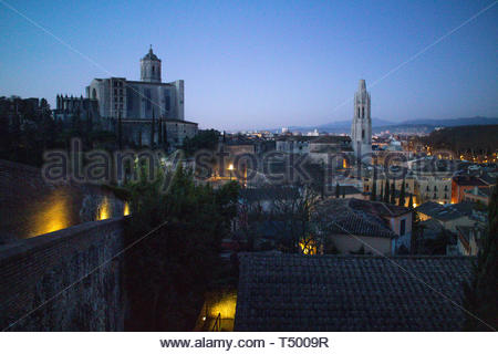 Sunrise from the top of the Medieval Wall overlooking the City of Girona, the Cathedral de Girona and the Basilica de Sant Feliu. - Stock Photo