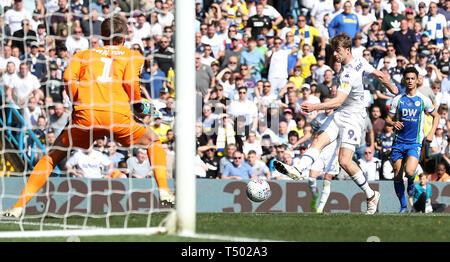 Leeds United's Patrick Bamford scores his teams 1st goal past Wigan Athletic goalkeeper Christian Walton, during the Sky Bet Championship match at Elland Road, Leeds. - Stock Photo