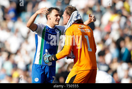 Wigan Athletic goalkeeper Christian Walton and Kal Naismith celebrate after their teams 2-1 win against Leeds United, during the Sky Bet Championship match at Elland Road, Leeds. - Stock Photo