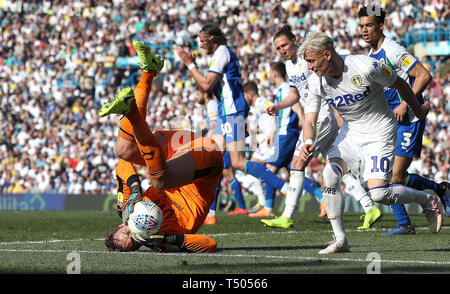 Wigan Athletic goalkeeper Christian Walton saves from Leeds United's Ezgjan Alioski (right), during the Sky Bet Championship match at Elland Road, Leeds. - Stock Photo