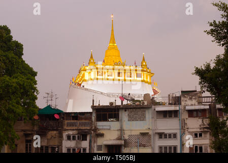 View of the chedi of the Temple of the Golden Mountain (Wat Saket) in the evening twilight. Bangkok, Thailand - Stock Photo