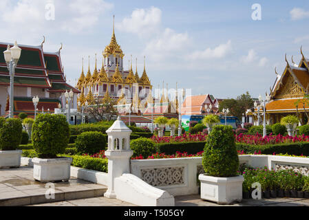 View of the old chedi Loha Prasat of the Buddhist temple of Wat Ratchanatdaram on a sunny day. Bangkok, Thailand - Stock Photo
