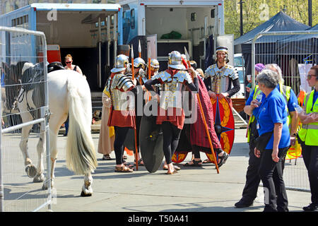 London, UK. 19th Apr 2019. On Good Friday, thousands gather in Trafalgar Square to watch The Passion of Jesus performed by the Wintershall Players. Sone Roman soldiers backstage with a horse Credit: PjrFoto/Alamy Live News - Stock Photo