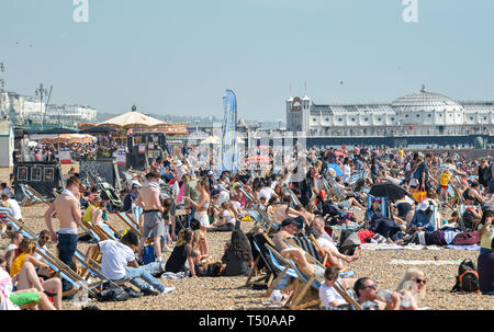 Brighton, UK. 19th Apr, 2019. Brighton beach is packed as Good Friday visitors enjoy the sizzling sunny weather as temperatures reach the mid twenties along the South Coast Credit: Simon Dack/Alamy Live News - Stock Photo