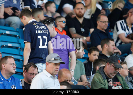 London, UK. 19th Apr, 2019. A Millwall fan with the popular slogan 'no-one likes us' on the back of their shirt during the EFL Sky Bet Championship match between Millwall and Brentford at The Den, London, England on 19 April 2019. Photo by Carlton Myrie. Editorial use only, license required for commercial use. No use in betting, games or a single club/league/player publications. Credit: UK Sports Pics Ltd/Alamy Live News - Stock Photo