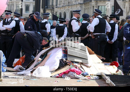 Oxford Circus, London, UK. 19th Apr, 2019. A huge pile of rubbish has been collected in Oxford Circus as police prepare to remove the environmental activists from Extinction Rebellion movement group. According to the Met Police, nearly 700 activists have been arrested since the demonstration started on 11 April 2019. Credit: Dinendra Haria/Alamy Live News - Stock Photo
