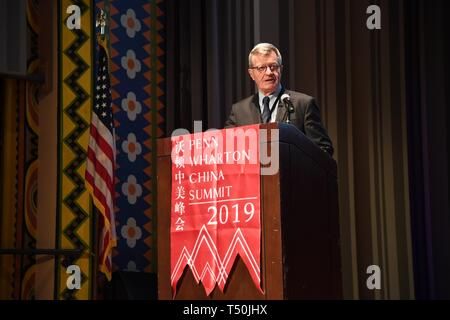 Philadelphia, USA. 19th Apr, 2019. Max Baucus, former U.S. ambassador to China, speaks at the opening ceremony of the 2019 Penn Wharton China Summit in Philadelphia, the United States, on April 19, 2019. Credit: Yang Chenglin/Xinhua/Alamy Live News - Stock Photo