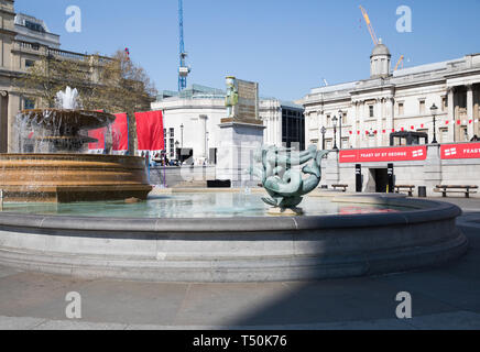 London, UK. 20th Apr, 2019. Preparations get underway for The Feast of St George in Trafalgar Square, London. Glorious sunshine adds to the English Country Garden feel with the hottest Easter for over 70 years forecast. Credit: Keith Larby/Alamy Live News - Stock Photo