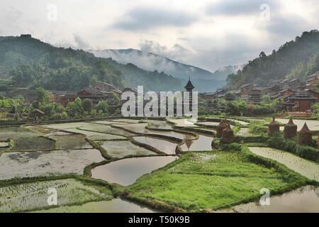 Liping. 20th Apr, 2019. Photo taken on April 20, 2019 shows the fog-shrouded Dong village of Zhaoxing, Liping County, southwest China's Guizhou Province. Credit: Ou Dongqu/Xinhua/Alamy Live News - Stock Photo