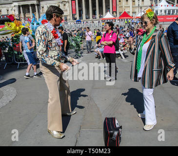 London, UK. 20th Apr, 2019. The annual Feat of St George in Trafalgar Square attracted thousands of people, who come to enjoy the seasoned warm weather with all the traditional celebrations for the Patron saint of England, The Pearly Queens and Kings were there to add the cockney side to the celebrations, as well as traditional music, food and all round fun@Paul Quezada-Neiman/Alamy Live New Credit: Paul Quezada-Neiman/Alamy Live News - Stock Photo