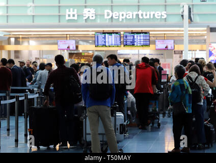 Tokyo, Japan. 19th Apr, 2019. The international terminal of Tokyo's Haneda airport is crowded with tourists to travel abroad on Friday, April 19, 2019. Japan will have ten-day Golden Week holidays from April 27 through May 6 since Emperor Akihito will abdicate on April 30 and Crown Prince Naruhito will ascend the throne on May 1. Credit: Yoshio Tsunoda/AFLO/Alamy Live News - Stock Photo