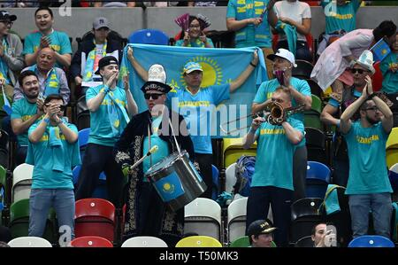 London, UK. 20th April, 2019. The Kazakhstan fans with their drums and trumpet. Rubber 1. World group II play off in the BNP Paribas Fed Cup. Copper Box arena. Queen Elizabeth Olympic Park. Stratford. London. UK. 20/04/2019. Credit: Sport In Pictures/Alamy Live News - Stock Photo
