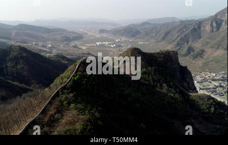 (190420) -- TIANJIN, April 20, 2019 (Xinhua) -- Aerial photo taken on April 19, 2019 shows the Huangyaguan Great Wall in the northern suburb of Tianjin, north China. The Huangyaguan Great Wall was built more than 14 centuries ago for border defense purpose. The structure winds its way for about 3,000 meters along the mountain areas of today's Jizhou District on the outskirts of Tianjin. (Xinhua/Yue Yuewei) - Stock Photo