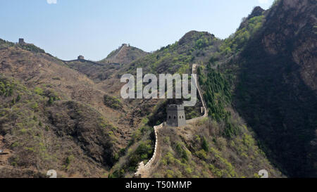 (190420) -- TIANJIN, April 20, 2019 (Xinhua) -- Aerial photo taken on April 19, 2019 shows the Huangyaguan Great Wall in the northern suburb of Tianjin, north China. The Huangyaguan Great Wall was built more than 14 centuries ago for border defense purpose. The structure winds its way for about 3,000 meters along the mountain areas of today's Jizhou District on the outskirts of Tianjin. (Xinhua/Li Ran) - Stock Photo