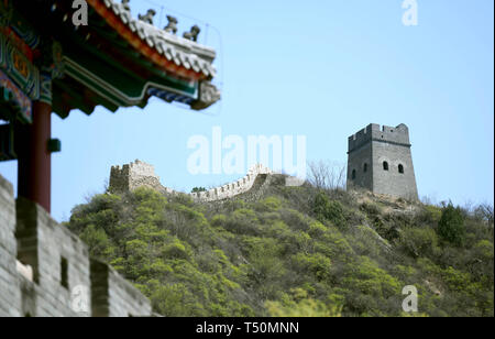 (190420) -- TIANJIN, April 20, 2019 (Xinhua) -- Photo taken on April 19, 2019 shows the Huangyaguan Great Wall in the northern suburb of Tianjin, north China. The Huangyaguan Great Wall was built more than 14 centuries ago for border defense purpose. The structure winds its way for about 3,000 meters along the mountain areas of today's Jizhou District on the outskirts of Tianjin. (Xinhua/Yue Yuewei) - Stock Photo