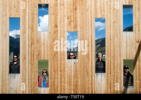 Fun with friend at ErlebnisSennerei Zillertal cheese farm in Mayrhofen, Austria - Stock Photo