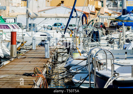 CABO DE PALOS, SPAIN - FEBRUARY 8, 2019   A beautiful marina with luxury yachts and motor boats in the tourist seaside town near of Cartagena - Stock Photo