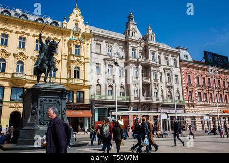 ZAGREB, CROATIA - APRIL, 2018: Locals and tourists at Zagreb main square next to the Statue of Count Ban Josip Jelacic - Stock Photo