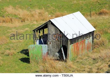 Tin Hut In Farmers Field - Stock Photo