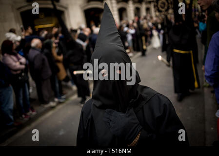 Hooded penitents parade during the Good Friday procession in Barcelona. - Stock Photo
