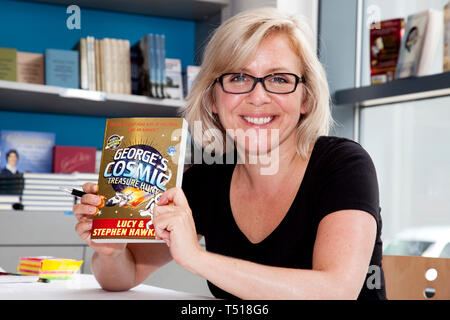 Lucy with her book George's Cosmic Treasure Hunt a savers of planet earth science fiction by Lucy Hawking and her father Pro Stephen Hawking. - Stock Photo