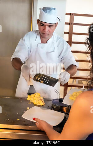 Cartagena Colombia El Laguito Hotel Dann hotel restaurant dining room Hispanic resident residents man man cook omelet chef employee scrambled eggs ser - Stock Photo