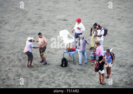 Cartagena Colombia El Laguito Hispanic resident residents man dancing musicians Caribbean Sea public beach - Stock Photo