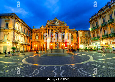 Catania, Sicily island, Italy: The facade of the theater Massimo Bellini and the fountain in the night lighting - Stock Photo