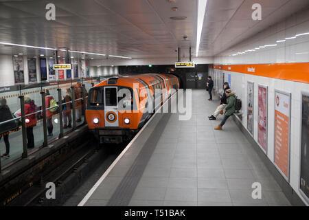 SPT subway train arriving at Glasgow Buchanan street underground station on the Glasgow underground / subway - Stock Photo