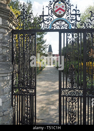 View looking through the iron entrance gate to Christ's Chapel of God's Gift at Dulwich Village in London - Stock Photo