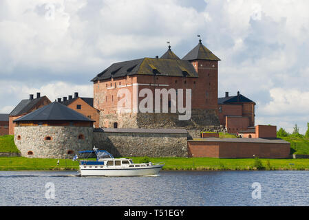 HAMEENLINA, FINLAND - JUNE 10, 2017: The boat on the Vanayavesi  lake against the background of the Hameenlinna fortress - Stock Photo