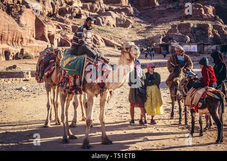 Camels in Petra historical city of Nabatean Kingdom in Jordan - Stock Photo