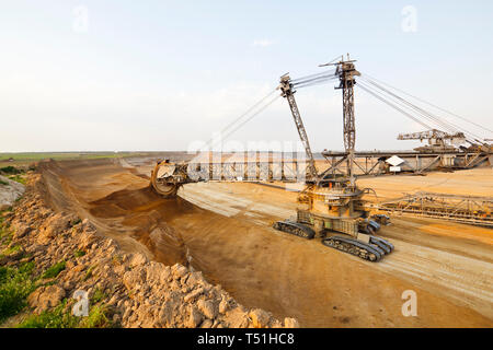A lignite pit mine with a giant bucket-wheel excavator, one of the worlds largest moving land vehicles. - Stock Photo