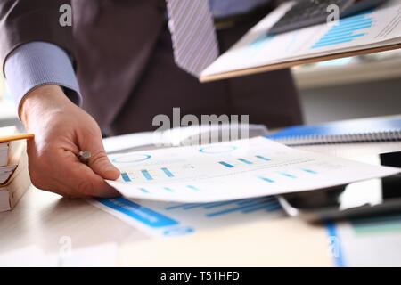 Accountant Calculate Tax Income Using Calculator - Stock Photo