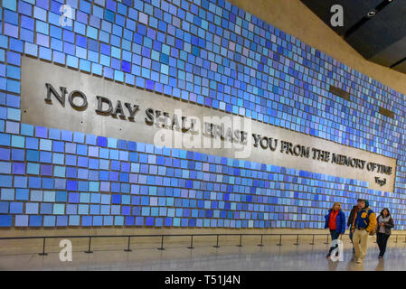 Inside of the National September 11 (9/11) Memorial and Museum. Entrance detail. Blue wall with text reading: No Day Shall Erase You From the Memory o - Stock Photo