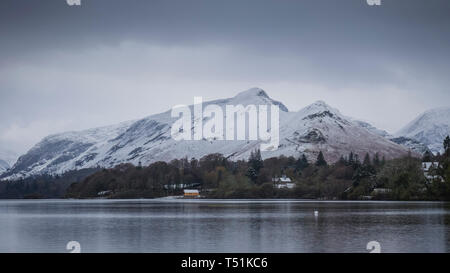 Catbells Fell with a coat of springtime snow, Derwentwater, Lake District, Cumbria, UK. - Stock Photo