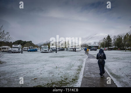 Camping and Caravanning Club site with Spring snow at Keswick, Cumbria, UK. - Stock Photo