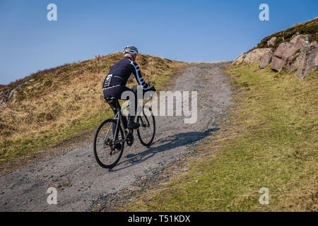 Male cyclist, cycling from Poolewe to Cove along the shore of Loch Ewe, west coast of Scotland. - Stock Photo