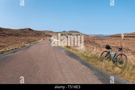 cycling from Poolewe to Cove along the shore of Loch Ewe, west coast of Scotland. - Stock Photo