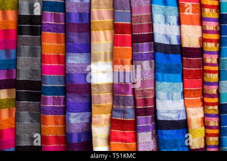 Colorful striped cloths for sale at the street stall, Essaouira, Morocco - Stock Photo